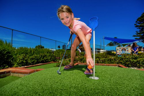 Girl Playing Mini Golf
